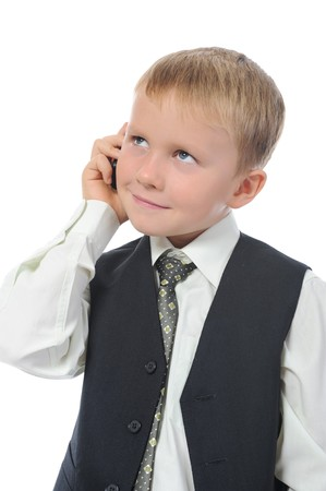 Little boy talking on the phone. Isolated on white background Stock Photo - 7890742
