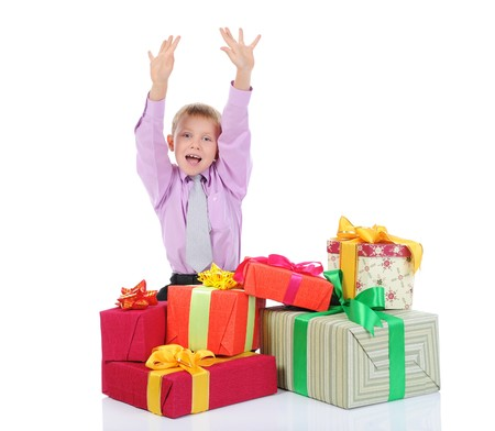 boy with a bunch of gifts . Isolated on white background Stock Photo - 7890715