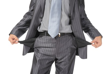 moneyless: man with empty pockets. Isolated on white background