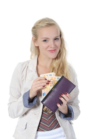long-haired blonde gets money from her purse. Isolated on white photo