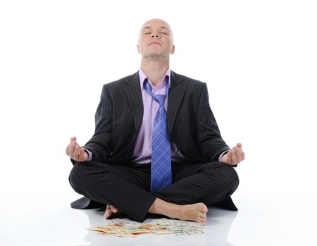 businessman meditating in yoga lotus. Isolated on white background photo