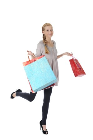 young blonde with shopping bags. Isolated on white background photo