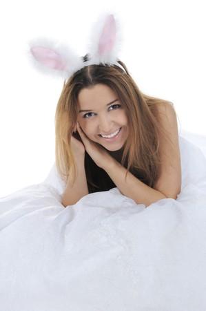 joyful girl with rabbit ears. Isolated on white background photo