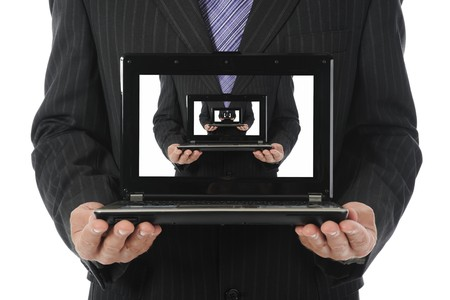 Businessman holding an open laptop. Isolated on white background Stock Photo - 7905822
