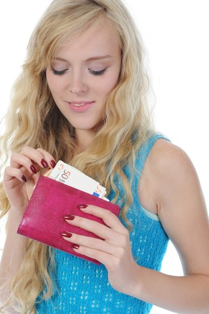 Young long-haired woman gets out of the pouch euro banknotes. Isolated on white photo