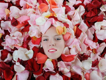 Portrait of a blonde in rose petals photo