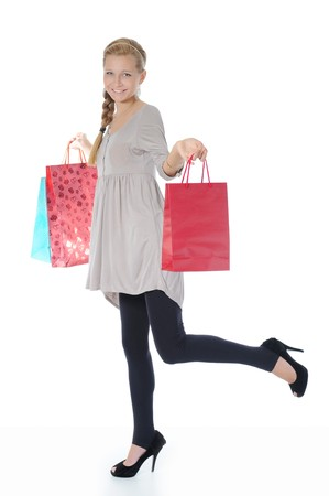 young blonde with shopping bags. Isolated on white background Stock Photo - 7890792