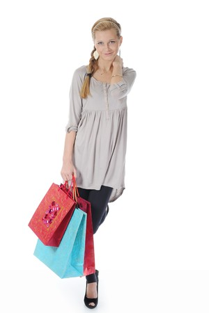 young blonde woman with shopping bags. Isolated on white background Stock Photo - 7890794
