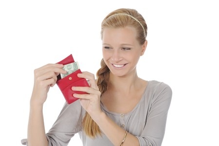 Young long-haired woman gets out of the pouch dollar banknotes. Isolated on white Stock Photo - 7890805
