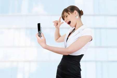 Happy smiling girl photographed themselves on the phone. Stock Photo - 7890790