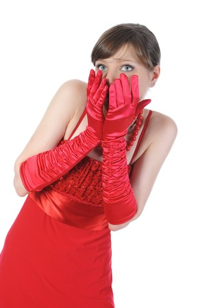 Portrait of a surprised girl in red gloves. Isolated on white background photo