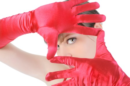 Portrait of a beautiful girl in the red gloves. Isolated on white background photo