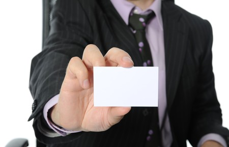 Business man handing a blank business card. Isolated on white background photo