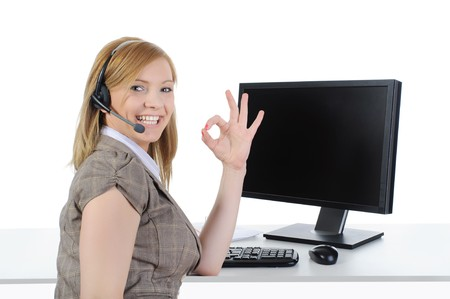 Beautiful girl operator at work in the office. Isolated on a white background photo