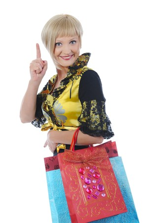 Happy girl with shopping bags in their hands. Isolated on white background photo