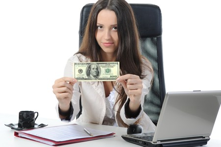 Joyful businesswoman in the office with  dollar banknotes. Isolated on white photo