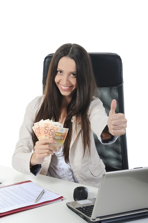 Joyful businesswoman in the office with a bundle of euro banknotes. Isolated on white photo