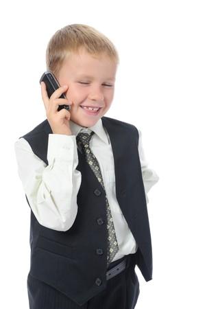 Little boy talking on the phone. Isolated on white background photo