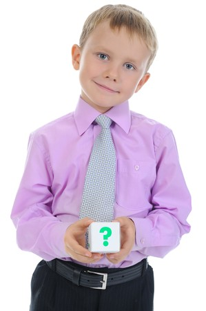 boy holds a cube. Isolated on white background photo