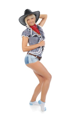 Young beautiful cowgirl. Isolated on white background photo