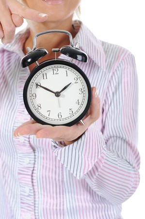 past midnight: woman with an alarm clock in a hand. Isolated on white background Stock Photo