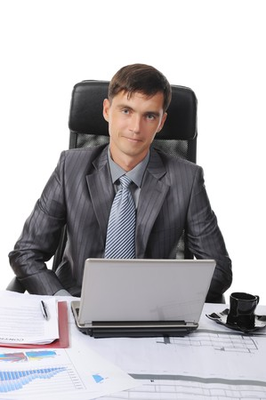 Businessman sitting before a laptop. Isolated on white background Stock Photo - 7890876