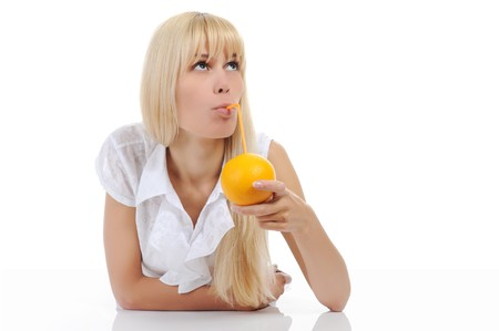Blonde woman with orange drink. Isolated on white background photo