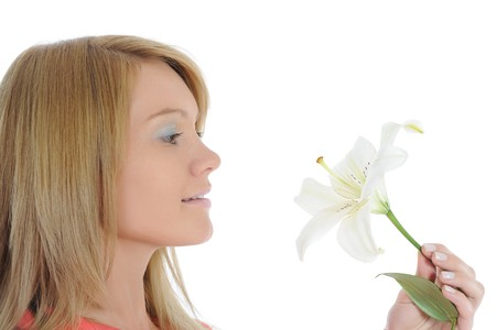 woman with lily in her hand. Isolated on white background photo