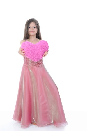 little girl with a beautiful heart. Isolated on white background photo