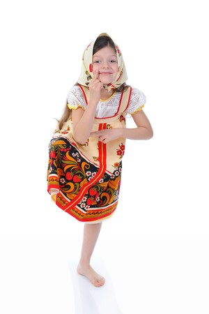 Little girl in a shawl dances. Isolated on white background photo