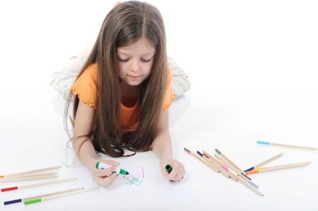 beautiful girl draws pencils. Isolated on white background photo