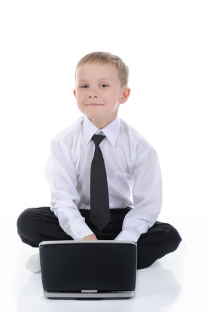 Little businessman with a laptop sitting on the floor. Isolated on white background Stock Photo - 7890891