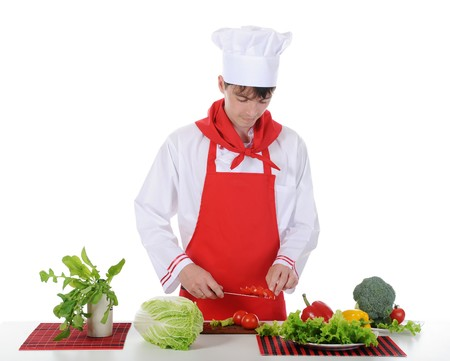 Chef and tomato on the knife. Isolated on white background Stock Photo - 7890895