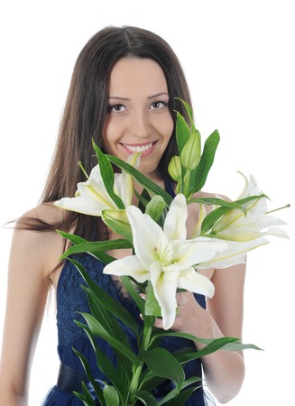 long-haired young brunette with a bouquet of lilies in his hands. Isolated on white photo