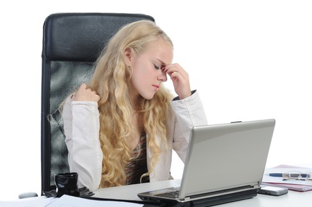 tired young blonde woman in the office at the workplace suffers headaches. Isolated on white photo
