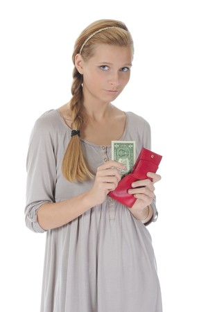 Young long-haired woman gets out of the pouch dollar banknotes. Isolated on white photo
