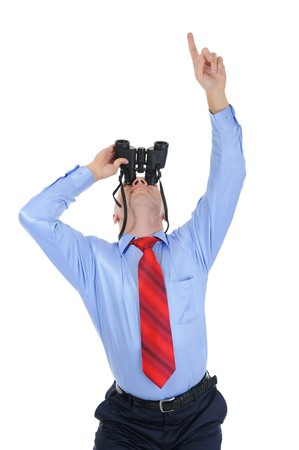 Image of a businessman looking up through binoculars. Isolated on white background Stock Photo - 7890990