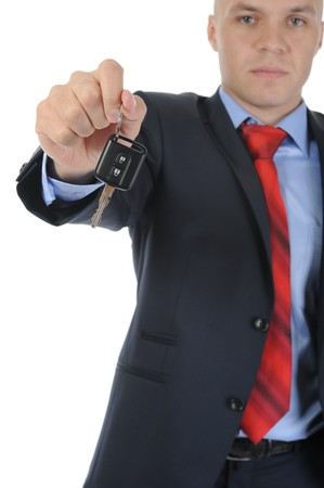 Image of a businessman gives the keys to the car. Isolated on white photo