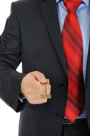 image of a businessman in a black suit which gives the key. Isolated on white background photo
