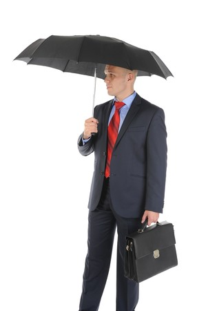 Image of a businessman with umbrella holding a briefcase. Isolated on white background photo