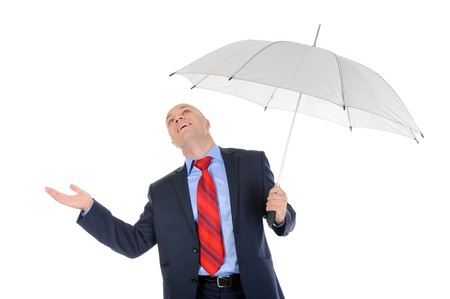 Image of a businessman with umbrella. Isolated on white background Stock Photo - 7890953