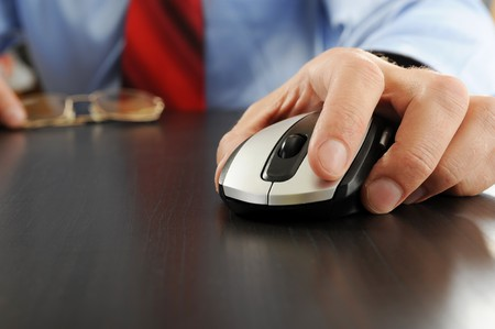 Image of a computer mouse in hand businessman Stock Photo - 7905854