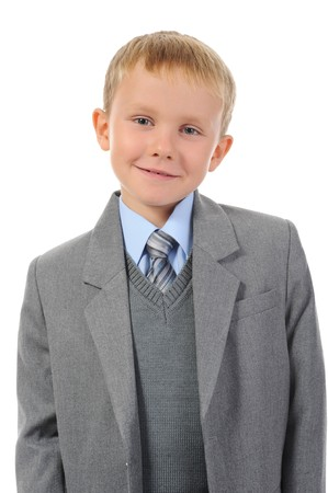 Boy in a business suit. Isolated on white background photo