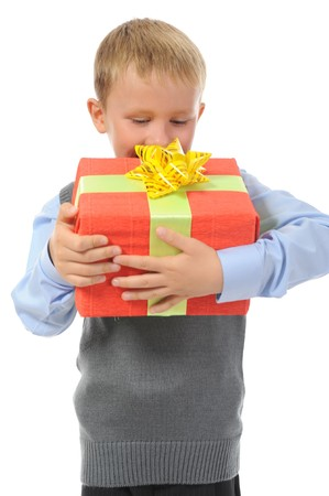 Joyful boy holding present box . Isolated on white background photo