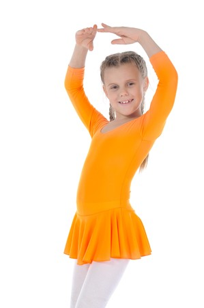 Little beautiful ballerina dancing in an orange dress. Isolated on white background photo
