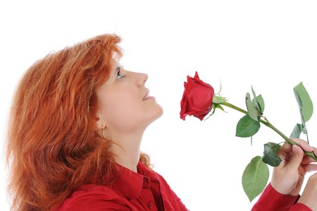 Red-haired woman with a red rose. Isolated on white background photo