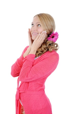 Pretty smiling girl in a pink looks up. Isolated on white background photo