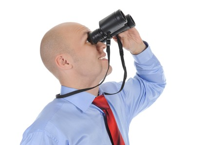Image of a bald businessman looking up through binoculars. Isolated on white background photo