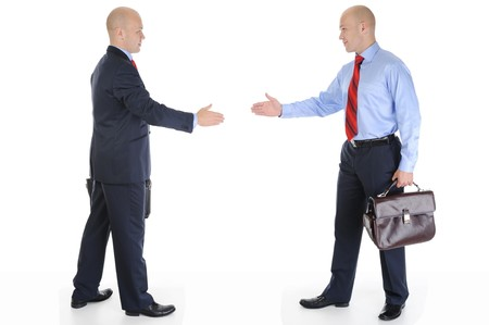 stretched out: Two businessmen stretched out their hands for a handshake. Isolated on white background Stock Photo