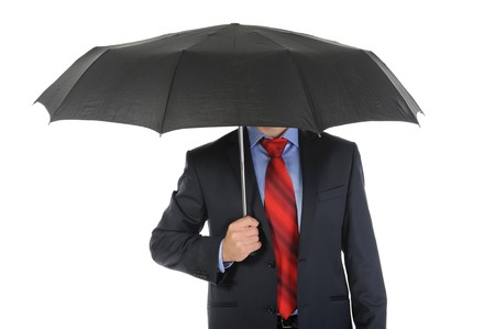 Image of a businessman with umbrella. Isolated on white background Stock Photo - 7890971